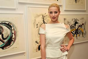 Amber Heard attends Tasya van Rees private viewing of Distorted Delicacies on June 22, 2011