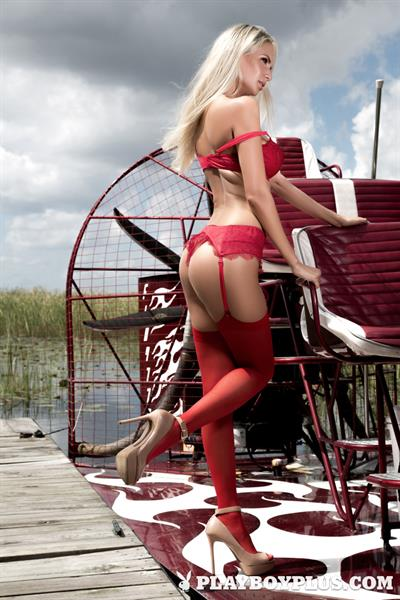 Playboy Cybergirl Andi Jay takes off red lingerie
