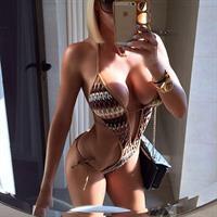 Alena Politukha in a bikini taking a selfie