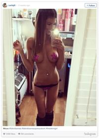 Carlie Jo in lingerie taking a selfie