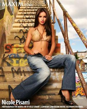 Nicole Pisarri taking off her jeans in a Maxim photo shoot