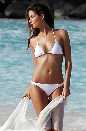 Victoria's Secret model Lily Aldridge in beach photoshoot wearing a white bikini