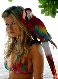Marisa Miller with a parrot for Sports Illustrated