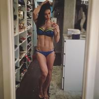Bella Falconi in a bikini taking a selfie