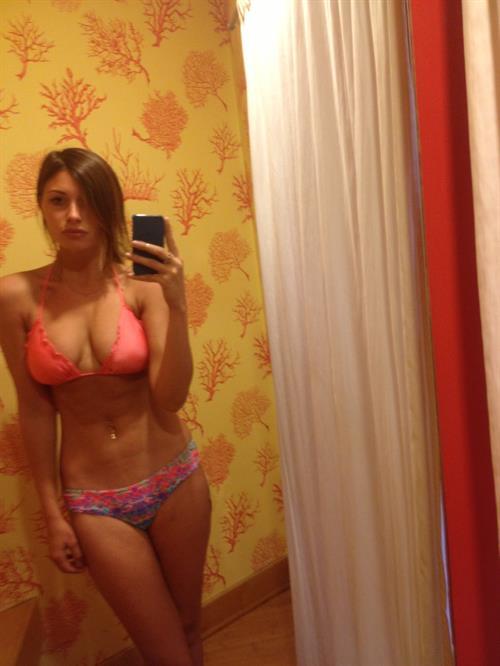 Aly Michalka in a bikini taking a selfie