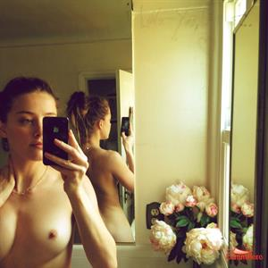 Amber Heard taking a selfie and - breasts