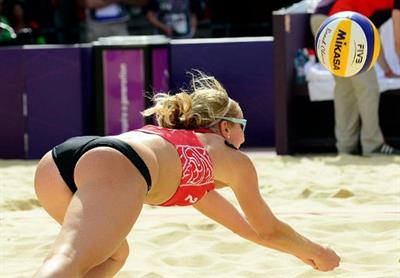 Russian Beach Volley Ball player dives for a ball during the 2012 London Olympics