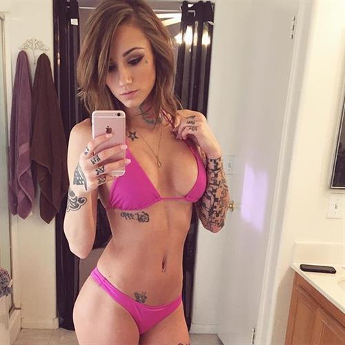 Brin Amberlee in a bikini taking a selfie