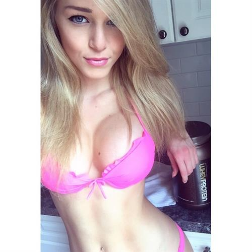 Courtney Tailor in lingerie taking a selfie