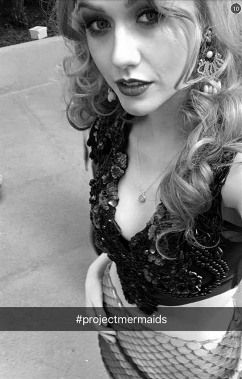 Katherine McNamara taking a selfie