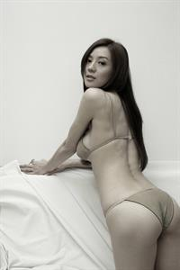 Cica Zhou in a bikini - ass