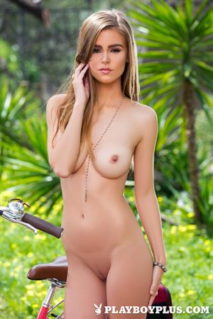 Playboy Cybergirl - Amberleigh West Nude outside with her bike at Playboy Plus!