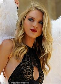 Martha Hunt chose a scorching black bralette for Victoria Secret's new holiday campaign.