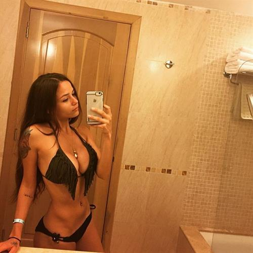 Melanie Pavola in a bikini taking a selfie
