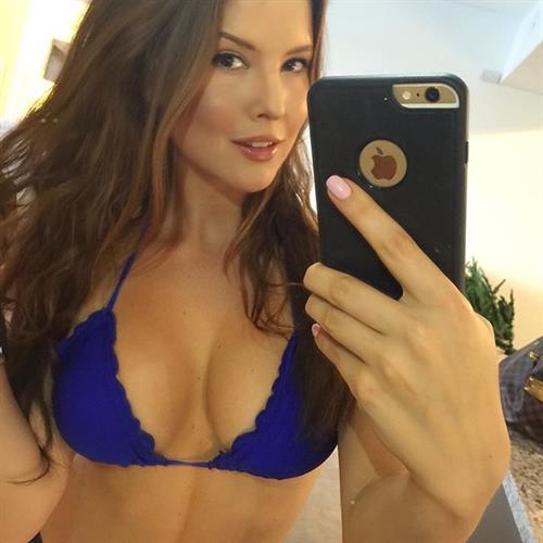 Amanda Cerny in a bikini taking a selfie