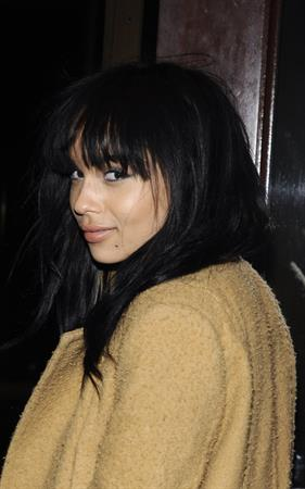 Zoe Kravitz in a long jacket and high heels