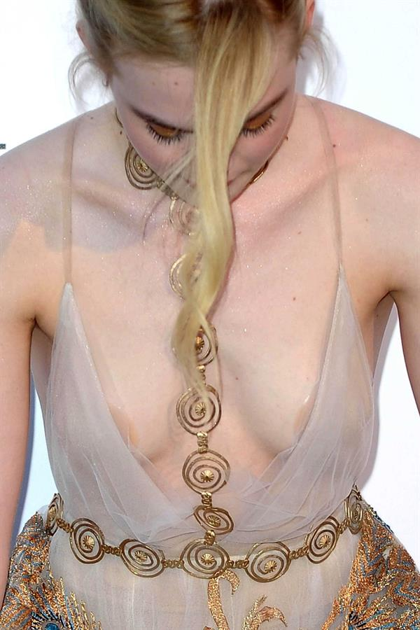 Elle Fanning down blouse shot at amfAR's 23rd Cinema Against AIDS Gala