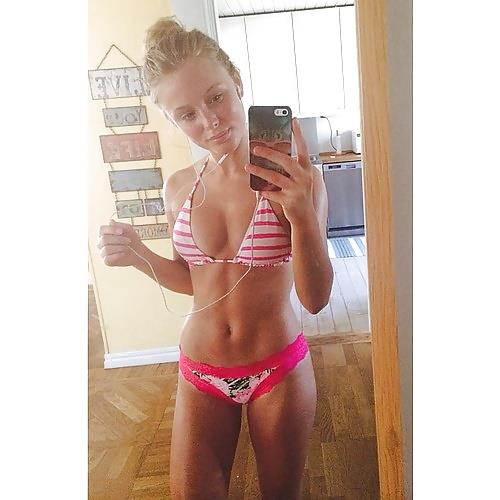 Zara Larsson in a bikini taking a selfie
