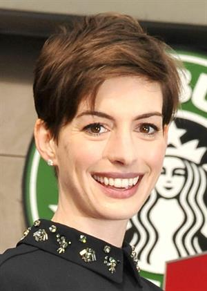 Anne Hathaway attends the Hugh Jackman Hollywood Walk Of Fame Ceremony in Hollywood December 13-2012