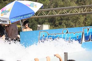 Katy Perry talks with a group of her friends after spending the afternoon at Raging Waters in San Dimas, California on August 12, 2012