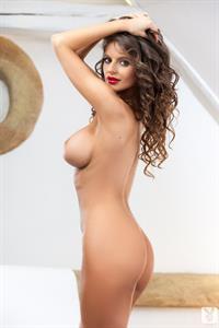 Dana Harem with curly hair posing for Playboy