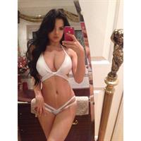 Demi Rose Mawby in a bikini taking a selfie