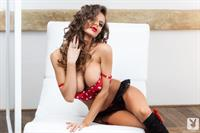 Dana Harem with curly hair posing for Playboy