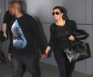 Kim Kardashian and Kanye West JFK airport in New York - 09 August 2012