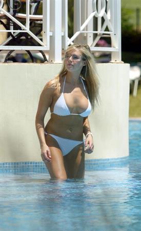 Abi Titmuss in a white bikini with a friend