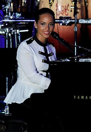 Alicia Keys performs on stage at Clive Davis 2012 pre Grammy gala on February 11, 2012