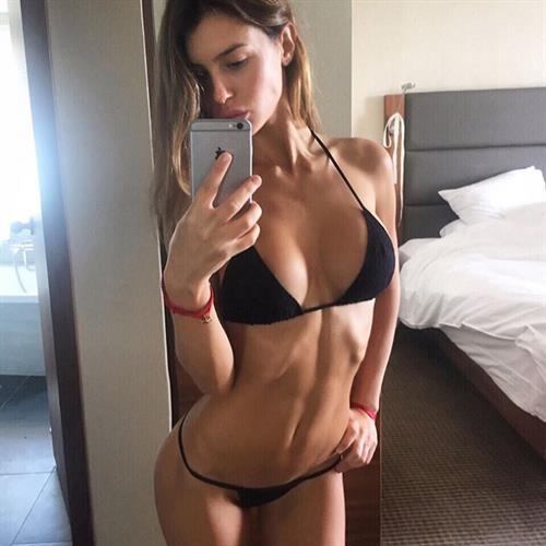 Silvia Caruso in a bikini taking a selfie