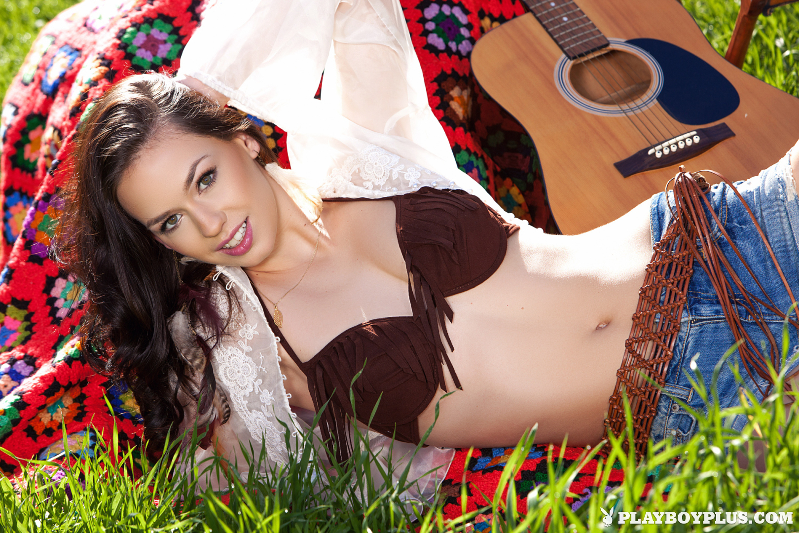Playboy Cybergirl Madi Meadows Nude with a guitar in a field