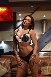 Gemma Massey takes off black and white lingerie