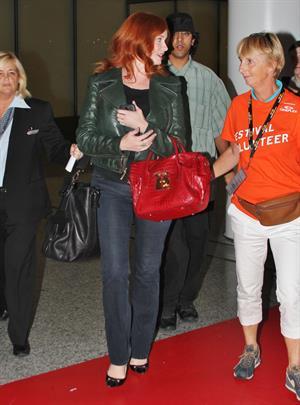 Christina Hendricks - Arriving on a flight at the Toronto International Airport - September 5, 2012