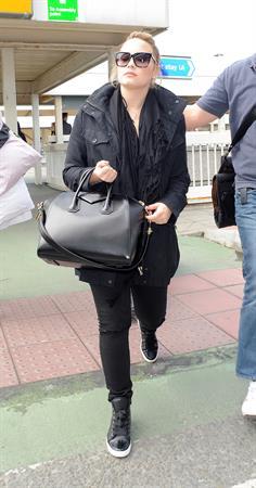 Demi Lovato - Leaves London Heathrow Airport in London (01.06.2013)