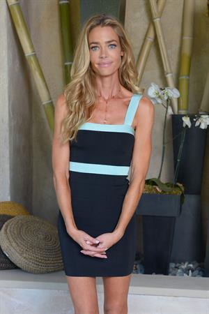 Denise Richards poses in a Kardashian Kollection dress in Beverly Hills May 22, 2013