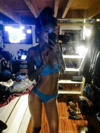 Jenah Yamamoto in a bikini taking a selfie