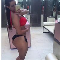 Ines Helene in a bikini taking a selfie
