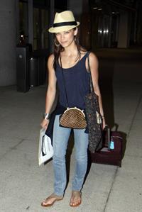 Kristin Kreuk - Pearson International Airport arrival candids in Toronto (July 16, 2012)