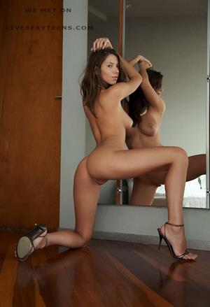 Lizzie Ryan posing with a mirror in high heels nude for Met-Art