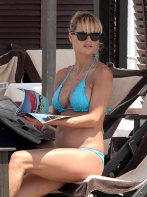 Michelle Hunziker Bikini candis at the beach in Forte dei Marmi on June 29, 2013