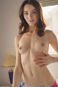 Adel Morel strips down and shows her tight pussy