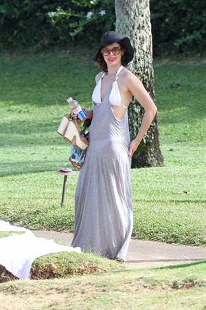Milla Jovovich on the beach in a bikini on New Years Eve in Maui, Hawaii December 31, 2012