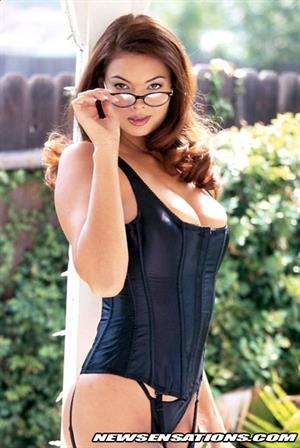 Tera Patrick strips off blue jacket and skirt