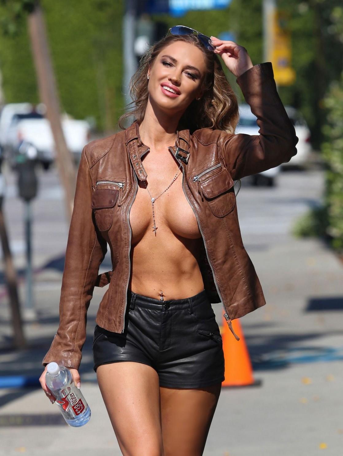 Nude women in leather bondage