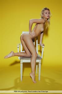 Hella G nude in a chair