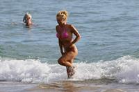 Pamela Anderson Wearing bikini on the beach in Hawaii - August 8, 2013