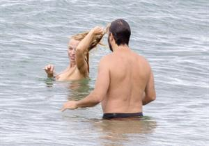 Pamela Anderson Pamela Anderson Going topless at the beach in France 02.10.13