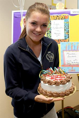 Agnieszka Radwanska is presented a cake for her birthday during the BNP Paribas Open March 6, 2013