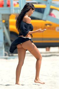 Nabilla Benattia in a bikini - ass